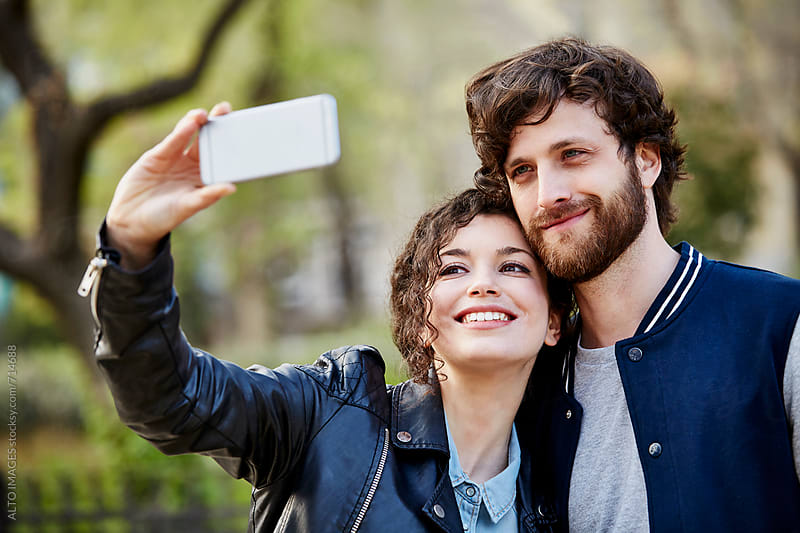 Couple Taking Selfie Through Smart Phone by ALTO IMAGES for Stocksy United