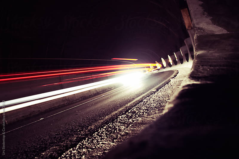 Motion blurred car lights in tunnel by Urs Siedentop & Co for Stocksy United