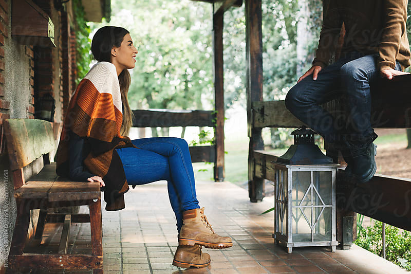 Couple sitting in the porch of a rural home. by BONNINSTUDIO for Stocksy United