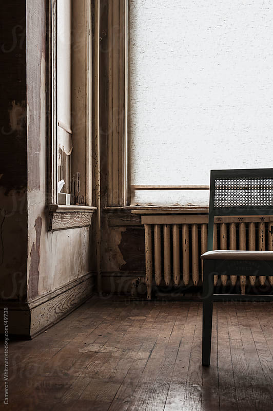 Chair in an abandoned house by Cameron Whitman for Stocksy United