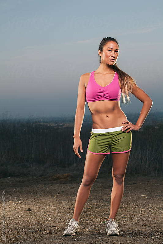 Full body picture of an athletic woman. by RZ CREATIVE for Stocksy United