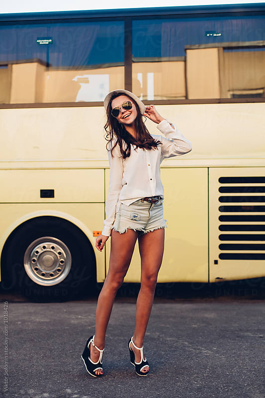 Pretty girl with long legs have fun on the street by Viktor Solomin for Stocksy United
