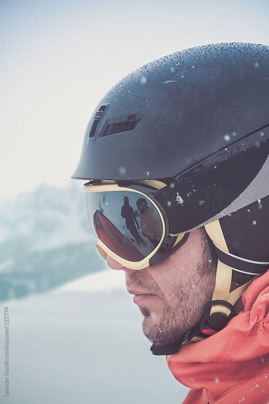 portrait of young male freeskier  with reflecting goggles by Leander Nardin for Stocksy United