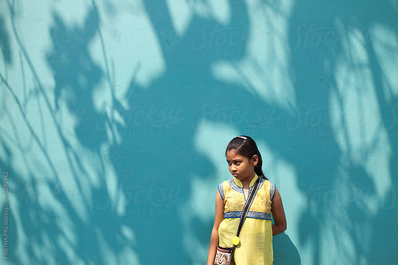Teenage girl standing against nice shadow on wall by PARTHA PAL for Stocksy United