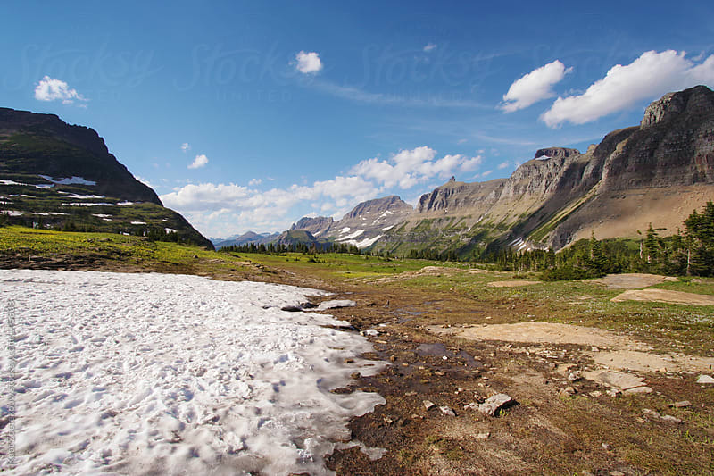Partially snow-covered landscape seen in Glacier National Park by Kaat Zoetekouw for Stocksy United