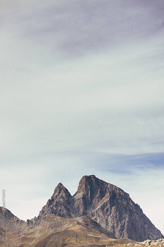 landscape with sky and mountain peaks by Javier Pardina for Stocksy United