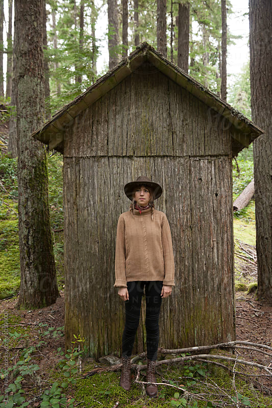 Woman And A Cabin by Carey Haider for Stocksy United