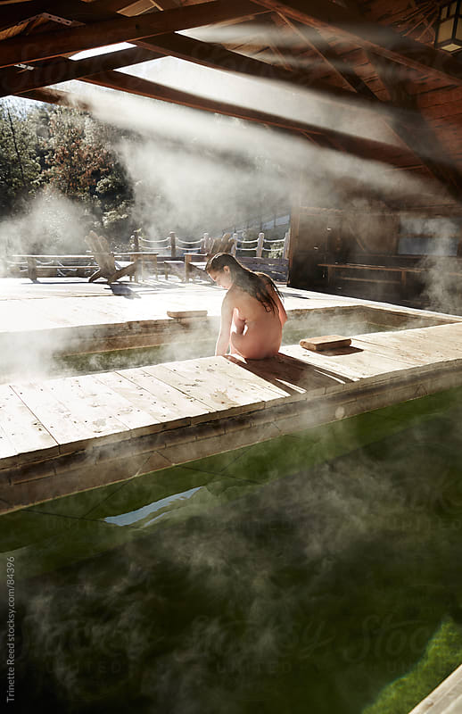 Young woman relaxing at Japanese spa and hot springs by Trinette Reed for Stocksy United