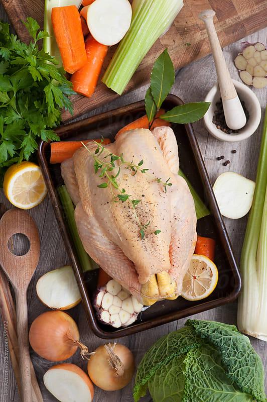 preparing roast chicken dinner by Lee Avison for Stocksy United