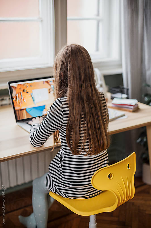 Girl Using a Laptop Computer by Lumina for Stocksy United