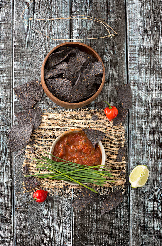 Organic Blue Nacho Corn Chips and Salsa by Jeff Wasserman for Stocksy United