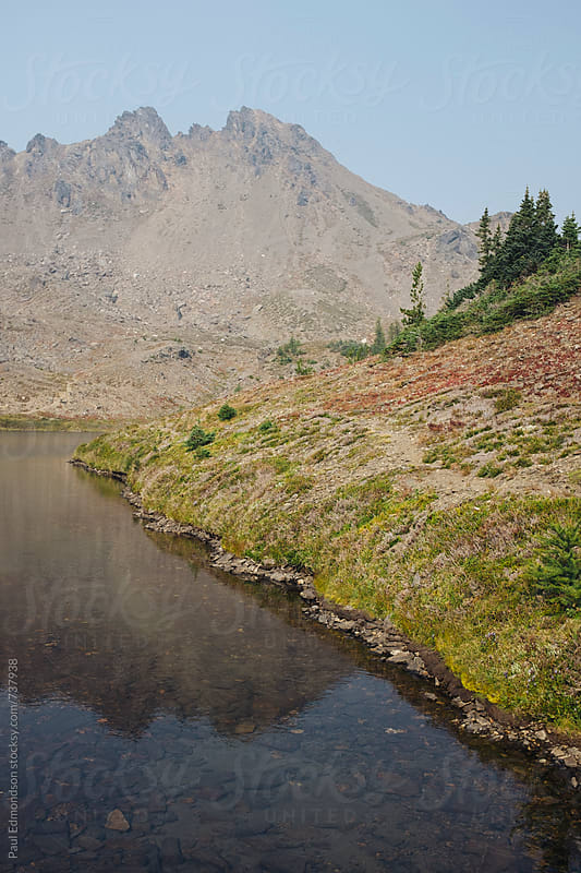 Small alpine lake in the Central Cascades by Paul Edmondson for Stocksy United
