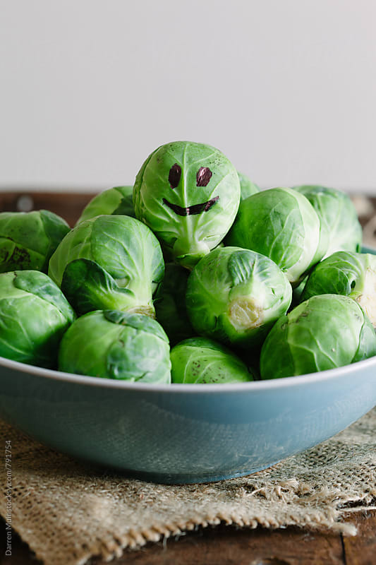 Smiley face on a Brussels sprout. by Darren Muir for Stocksy United