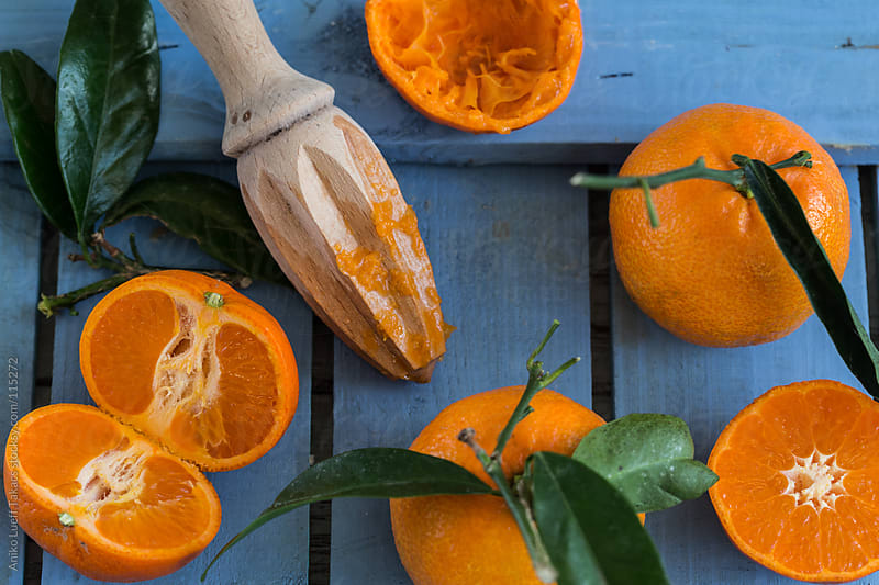 Clementines on a blue board by Aniko Lueff Takacs for Stocksy United