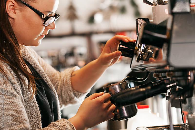 Bakery: Barisa Steams Milk At Espresso Machine by Sean Locke for Stocksy United