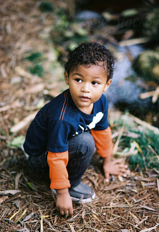 African American boy exploring outdoors by Marlon Richardson for Stocksy United