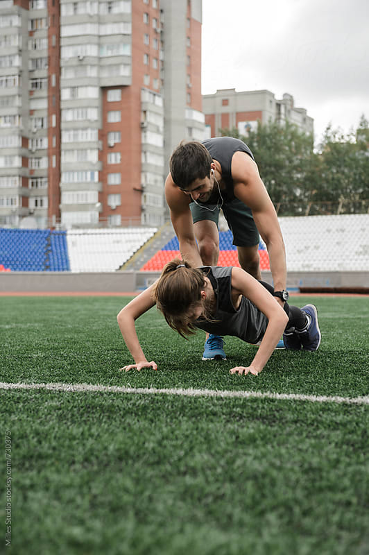 Man and woman doing push up by Milles Studio for Stocksy United