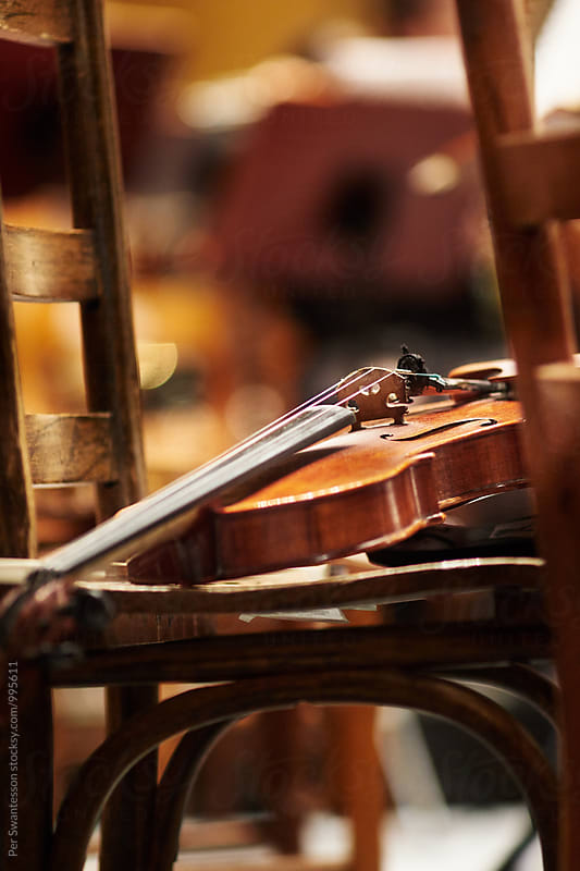 Violin on chair by Per Swantesson for Stocksy United