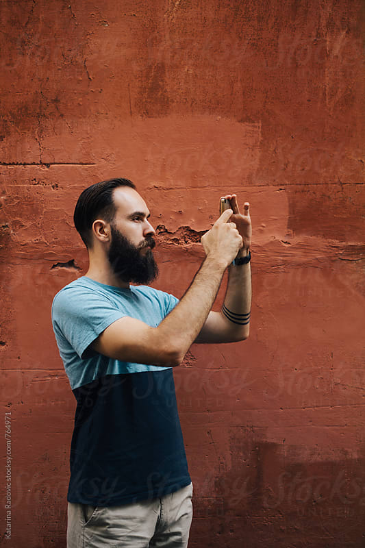 Bearded Man Taking Photos  by Katarina Radovic for Stocksy United