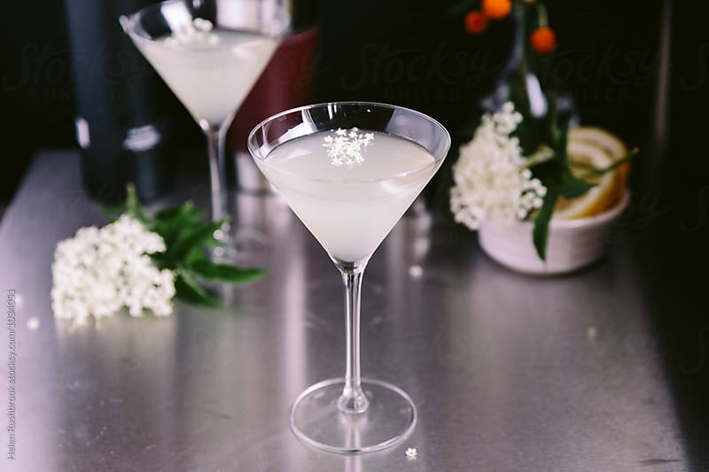 Elderflower cocktail by Helen Rushbrook for Stocksy United