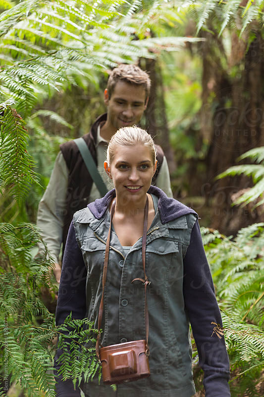 Young laughing couple bushwalking by Ben Ryan for Stocksy United