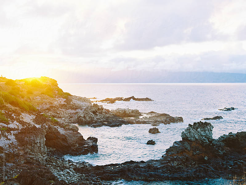 sunset scenic over cliffs and ocean on north shore of maui by wendy laurel for Stocksy United