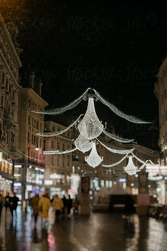 Street festive Christmas lights by Beatrix Boros for Stocksy United