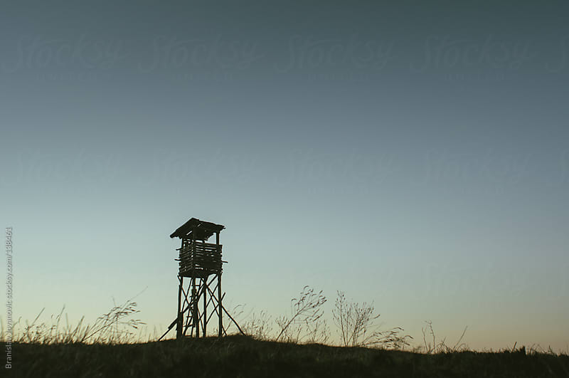 A Silhouette of an Watchtower by Branislav Jovanovic for Stocksy United