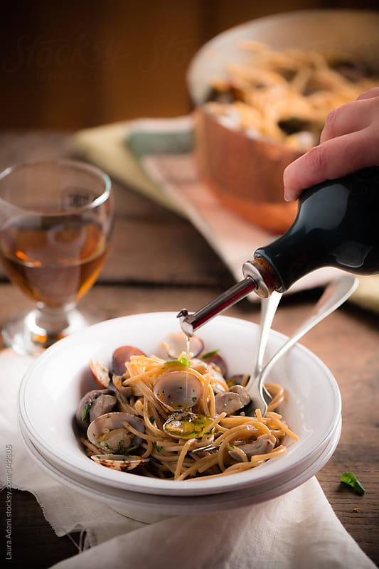 spaghetti with clams and porcini by Laura Adani for Stocksy United