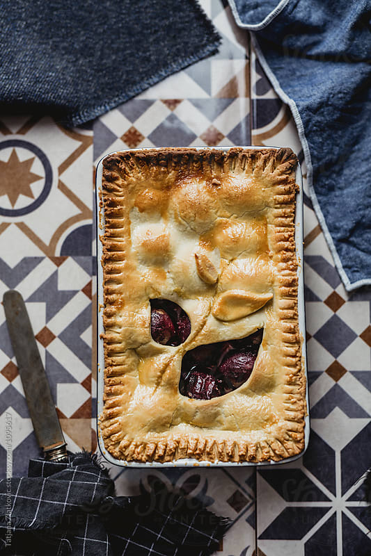 Plum pie by Tatjana Zlatkovic for Stocksy United