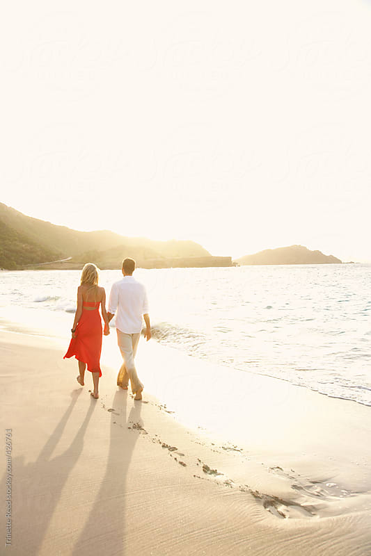Couple walking on the beach  by Trinette Reed for Stocksy United