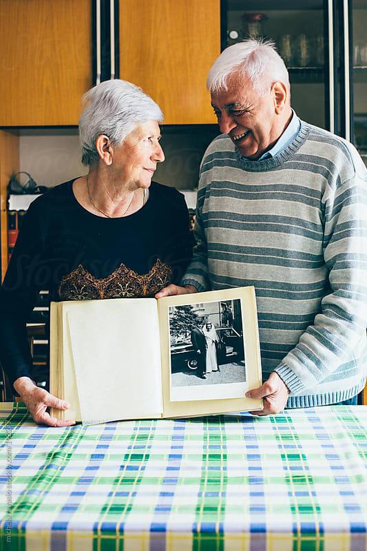 Elderly couple smiling by michela ravasio for Stocksy United