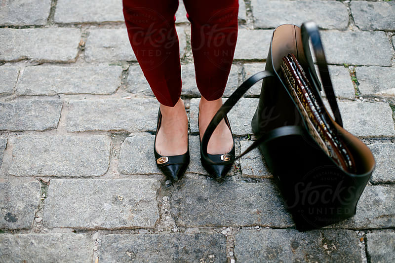 Close up of woman's shoes and bag by Jennifer Brister for Stocksy United