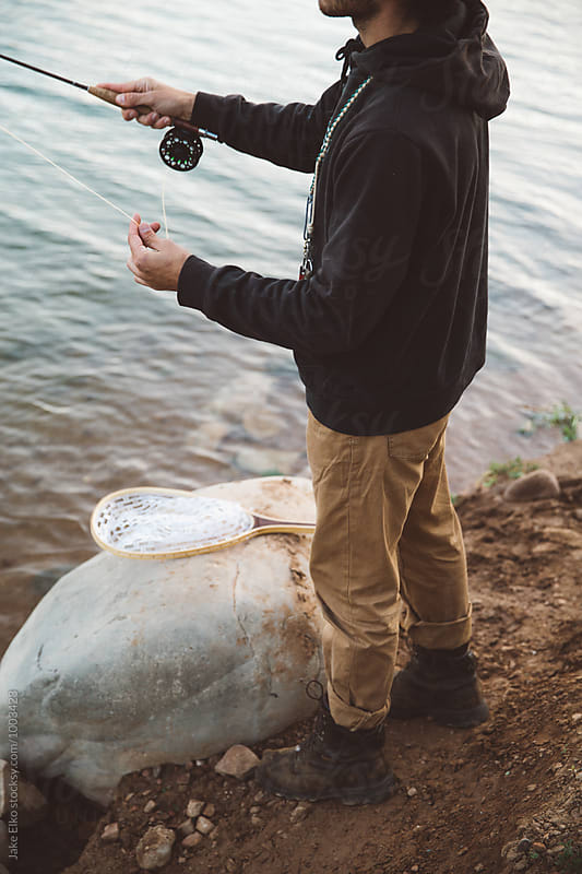 Man Fly Fishing in Utah Lake  by Jake Elko for Stocksy United