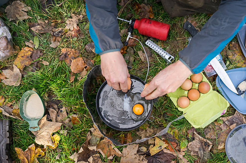 making breakfast while camping by Tristan Kwant for Stocksy United