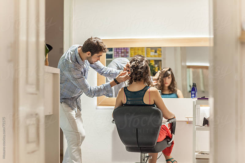 Hairdresser and Client in a Salon by Mosuno for Stocksy United