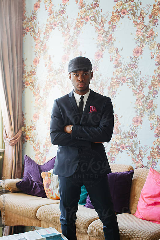 Stylish Young Black Man Standing in Bright Beautiful Living Room by Julien L. Balmer for Stocksy United