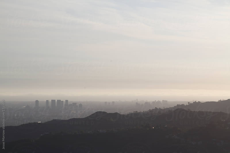 sunset view of the skyline of los angeles by Jesse Morrow for Stocksy United