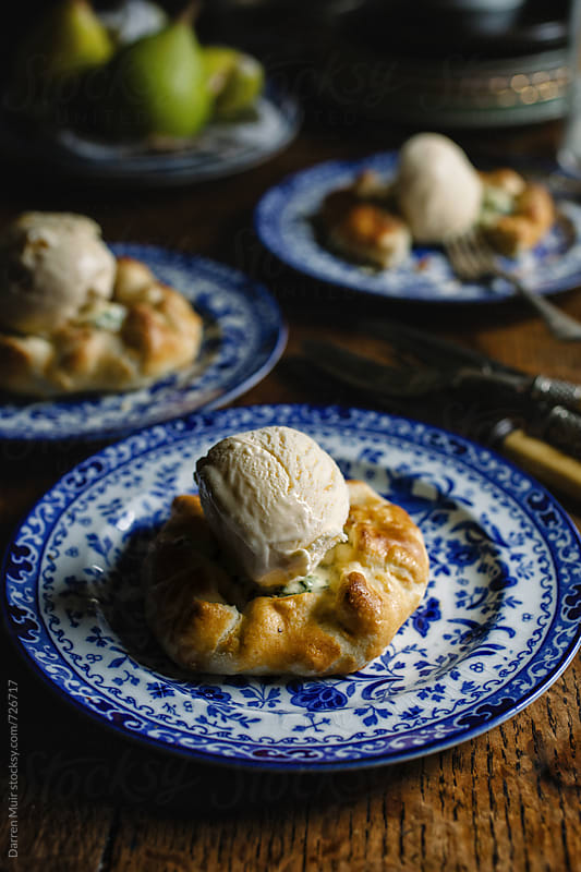 Blue cheese and pear galettes with vanilla ice-cream. by Darren Muir for Stocksy United