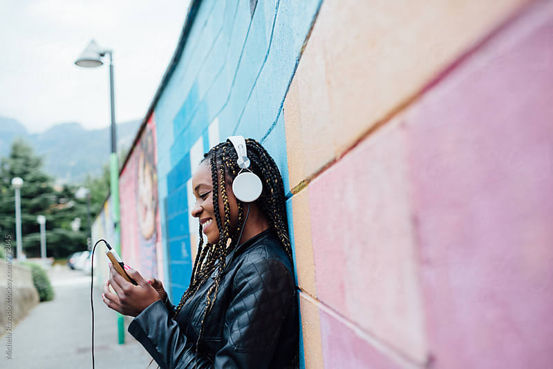 Listening to music in the street by michela ravasio for Stocksy United