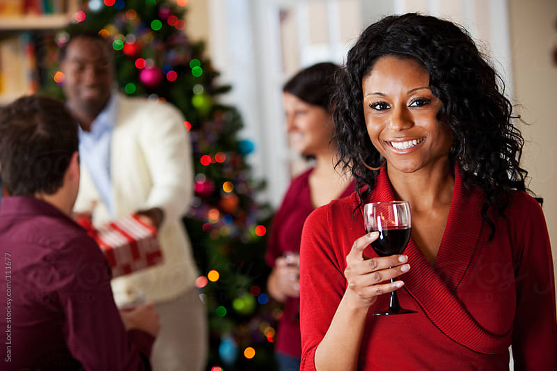 Christmas: Woman with Wine at Party by Sean Locke for Stocksy United