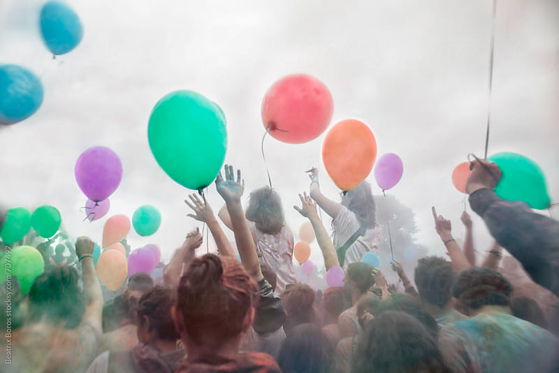 Balloons and hands up in the air by Beatrix Boros for Stocksy United
