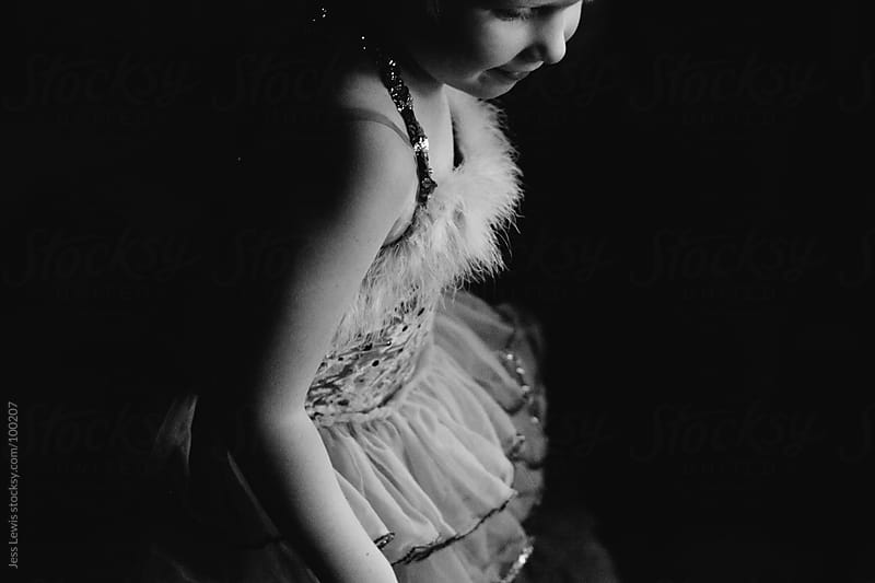 child wearing tutu (black and white) by Jess Lewis for Stocksy United