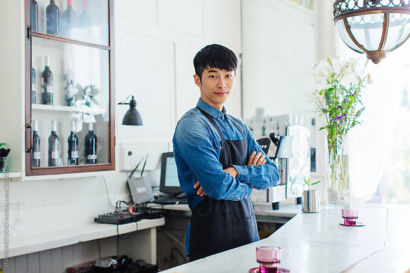 Portrait of a handsome asian male entrepreneur in a cool restaurant. by BONNINSTUDIO for Stocksy United
