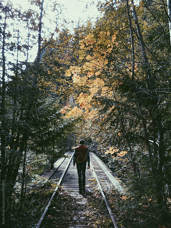 Man Walking Onto Train Trestle by Kevin Russ for Stocksy United