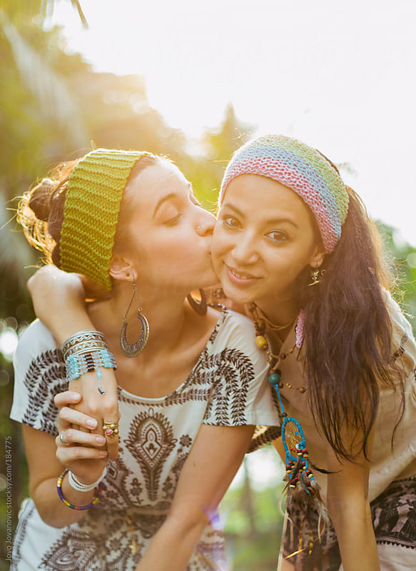 Friendship - two girls having fun in front of camera by Jovo Jovanovic for Stocksy United