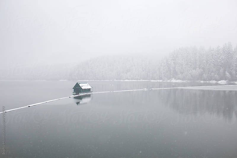 Lake House covered in Snow  by Sophia Hsin for Stocksy United
