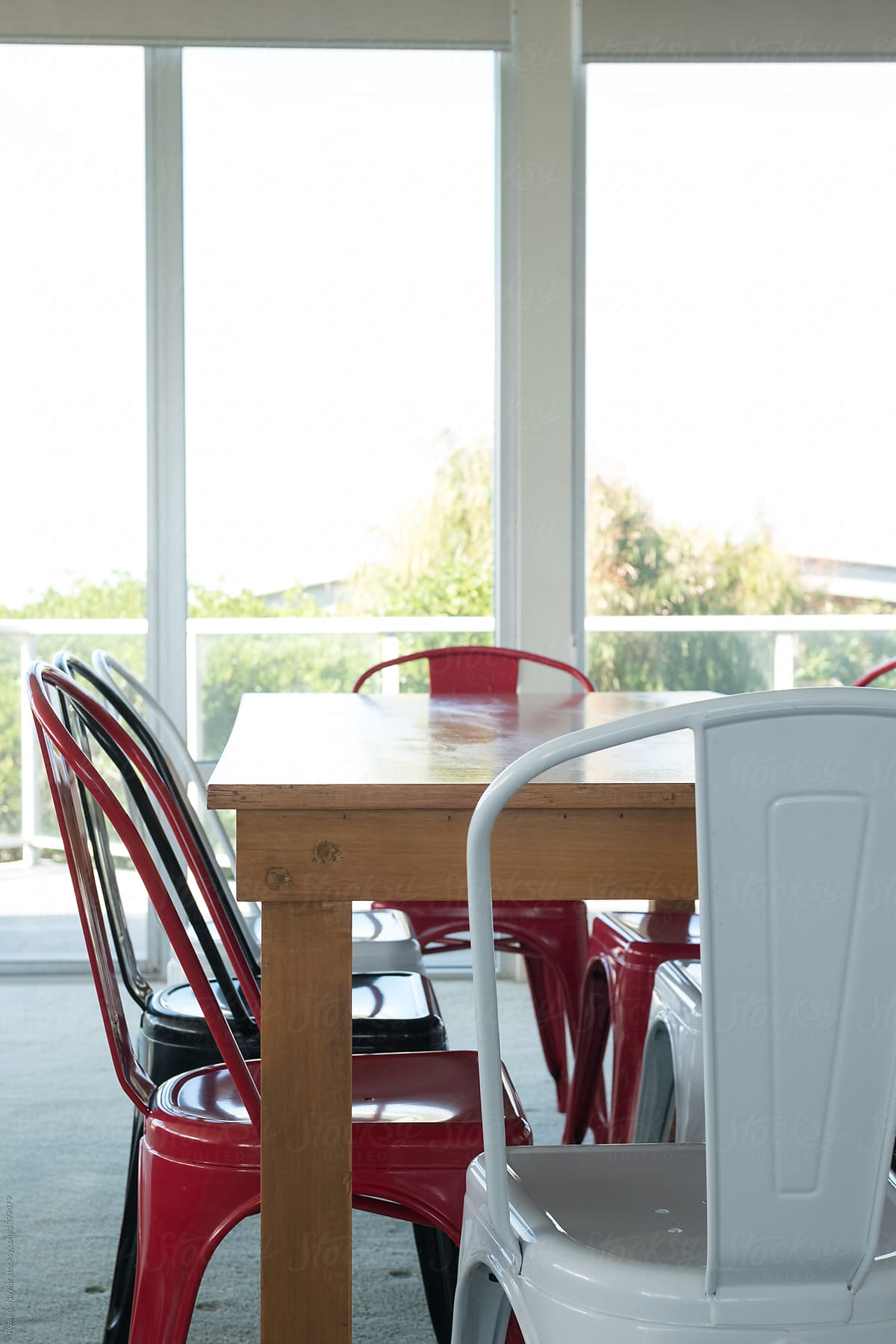 Picture of: Colorful Metal Dining Chairs In Red White And Black By Rowena Naylor Stocksy United