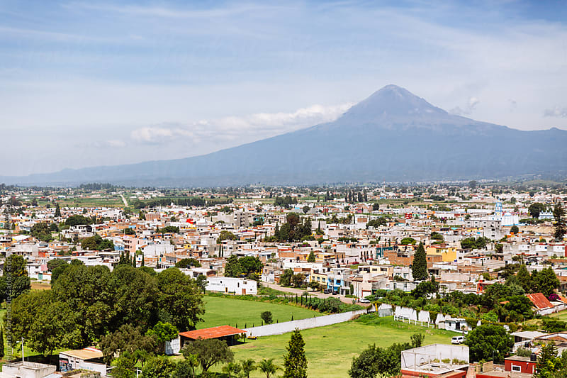 Scenic view of volcano in Cholula and the city in front of it in Mexico by Alejandro Moreno de Carlos for Stocksy United