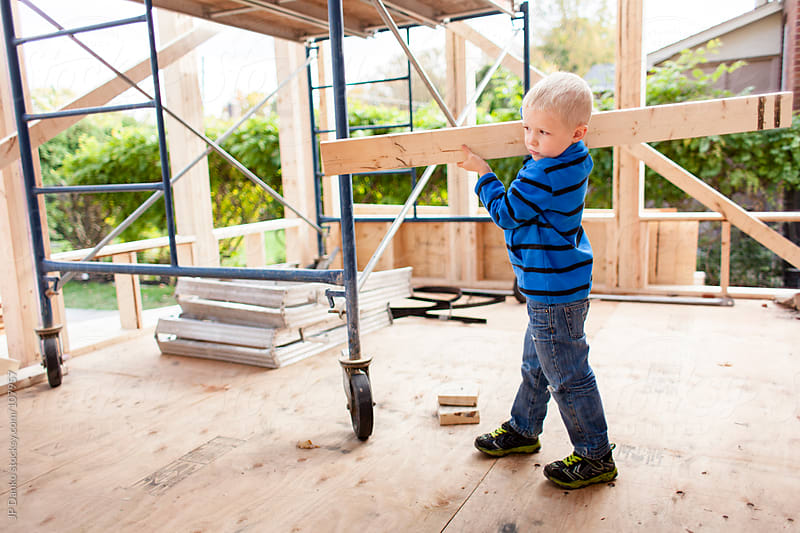 Little Boy Carrying Lumber Training for Career as Home Builder by JP Danko for Stocksy United